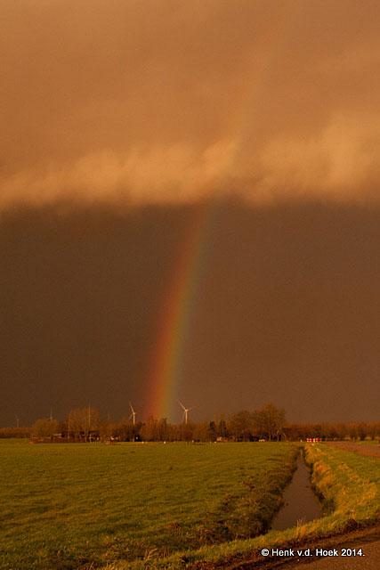 Regenboog in de polder Arkemheem.